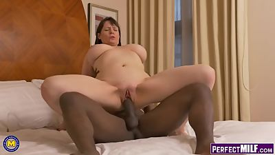 Big Titted MILF Takes on BBC
