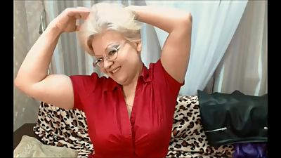 Cute Russian granny flexes her big..