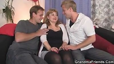 Mature woman in stockings swallows two..