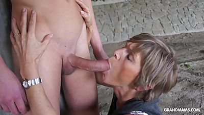 Horny old cougar tapes up her young..