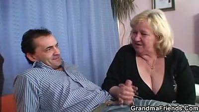 Two guys have fun with busty blonde..
