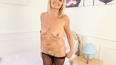 English milf Dolly gets naughty in..