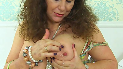 English milf Gilly pleasures her large..