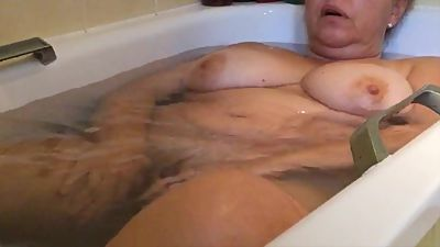 Voyeur hidden cam unaware milf in bathroom