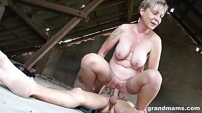 Hot blonde granny Sanny fucks her..